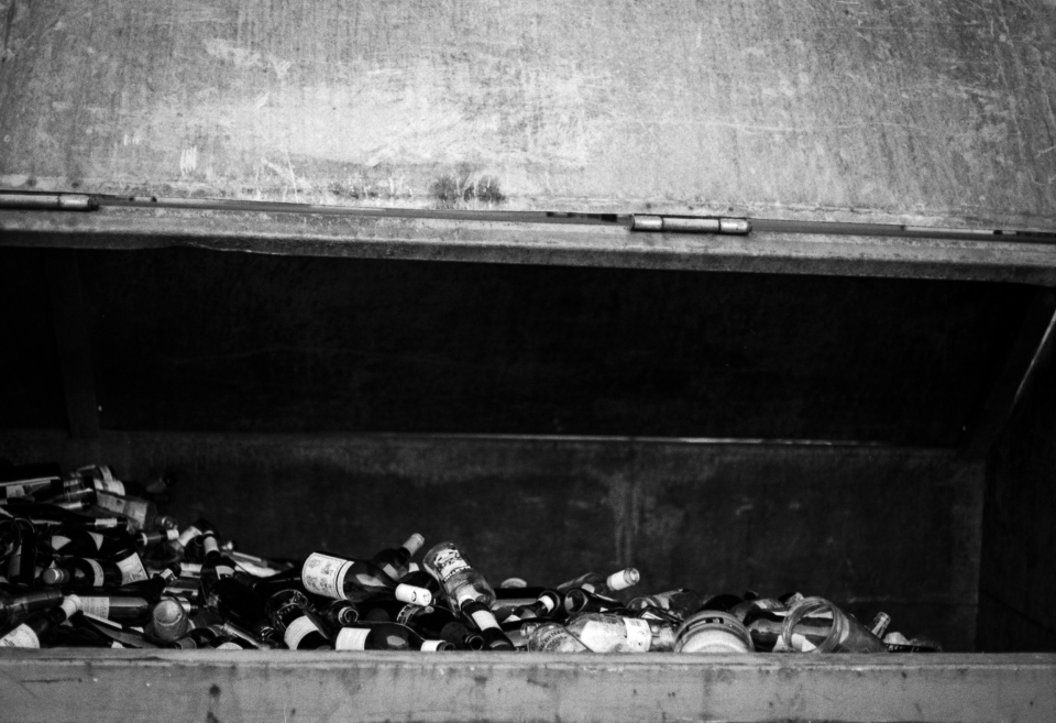 Empty bottles in a bin